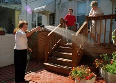 Ginny on the left, holding the hose. Credit: Patterson Park Neighborhood Association
